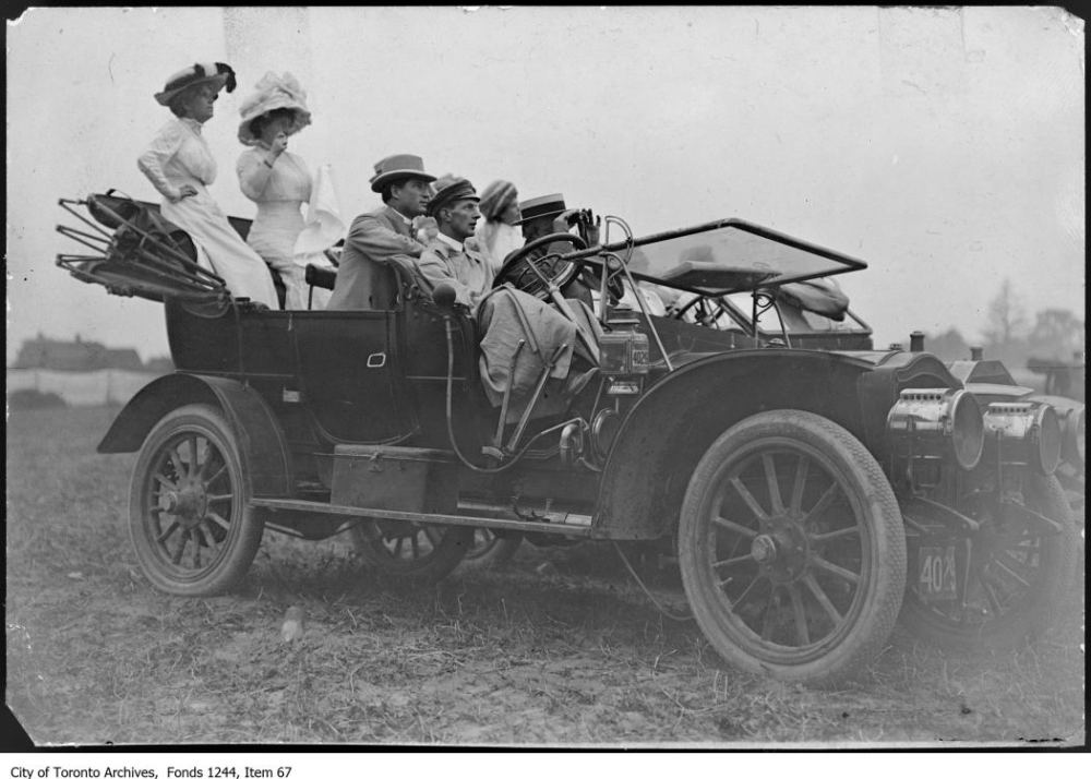People in automobile watching first airplane flight, Weston. - July, 1910